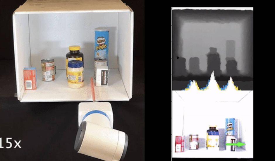 un bras robotique range des objets dans une etager - Pronto los robots podrán mover objetos en los estantes con precisión
